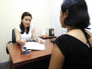 aesthetic doctor consult patient for treatment