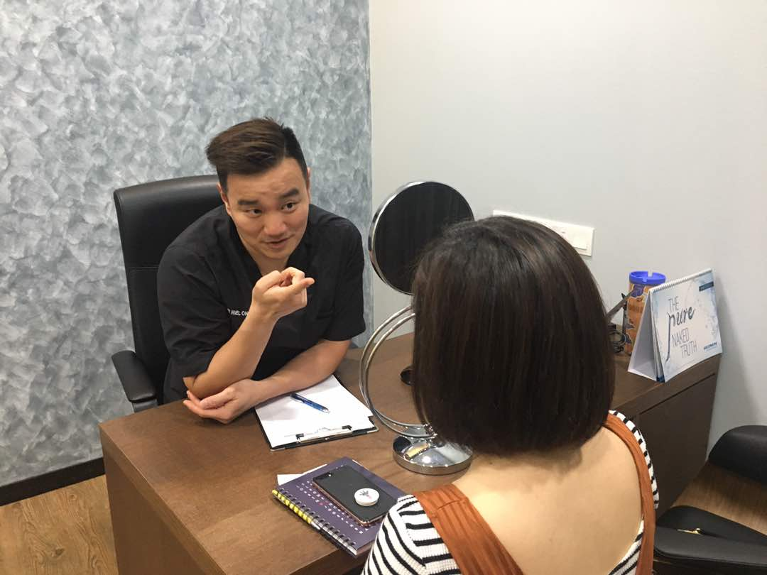 Dr. Nigel Ong consulting his patient